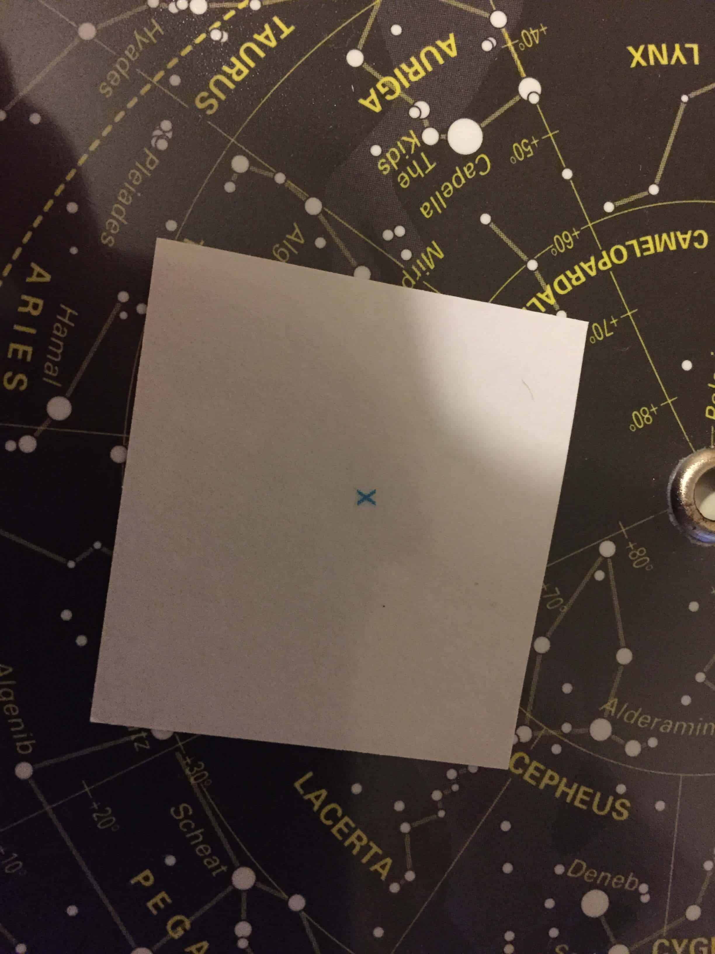 What's the little blue cross on a planisphere?