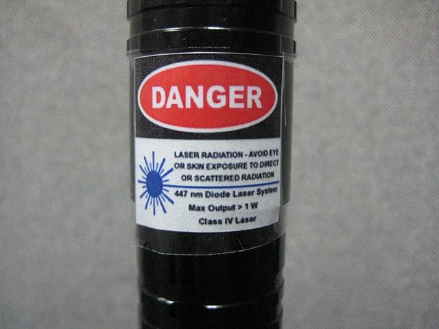 Danger sticker on laser pointer